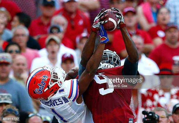 Amari Cooper of the Alabama Crimson Tide pulls in this touchdown reception against Vernon Hargreaves III of the Florida Gators at BryantDenny Stadium...