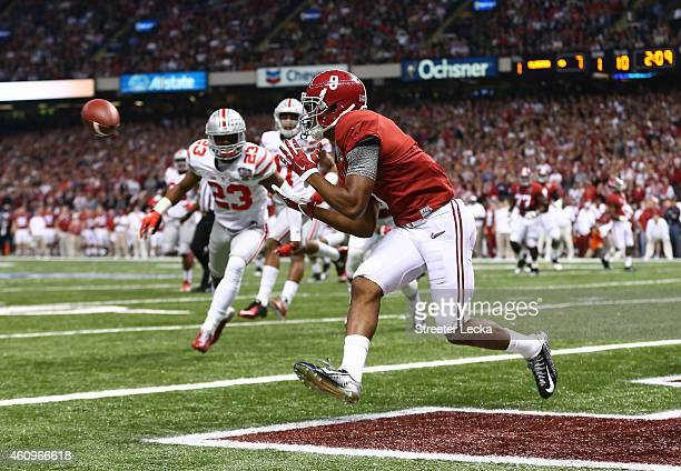 Amari Cooper of the Alabama Crimson Tide scores a touchdown in the first quarter against the Ohio State Buckeyes during the All State Sugar Bowl at...