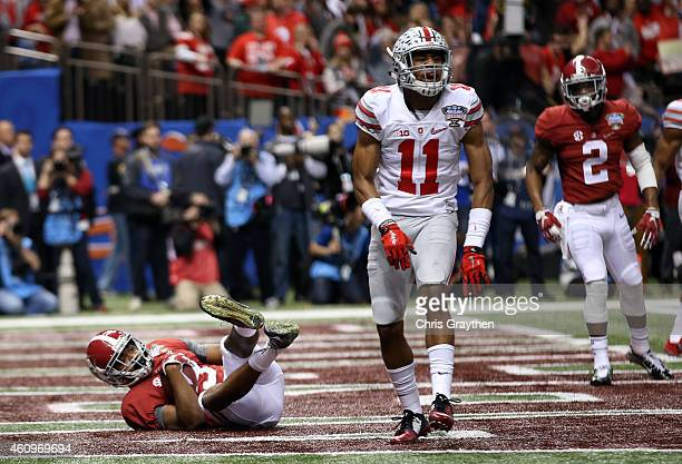 Amari Cooper of the Alabama Crimson Tide scores a touchdown in the fourth quarter against the Ohio State Buckeyes during the All State Sugar Bowl at...
