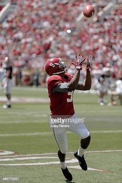 Amari Cooper of the Crimson team participates in warmups prior to the University of Alabama ADay spring game at BryantDenny Stadium on April 19 2014...