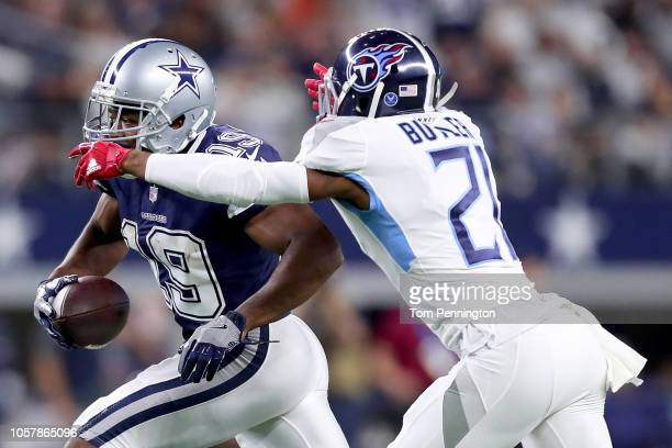 Amari Cooper of the Dallas Cowboys carries the ball against Malcolm Butler of the Tennessee Titans in the second quarter at ATT Stadium on November 5...