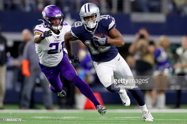 Amari Cooper of the Dallas Cowboys carries the ball against Mike Hughes of the Minnesota Vikings in the fourth quarter at AT&T Stadium on November...