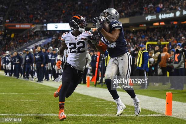 Amari Cooper of the Dallas Cowboys catches a pass for a touchdown in front of Kevin Toliver of the Chicago Bears during the second half of a game at...