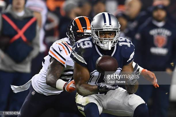 Amari Cooper of the Dallas Cowboys catches a pass in front of Kevin Toliver of the Chicago Bears during a game at Soldier Field on December 05 2019...