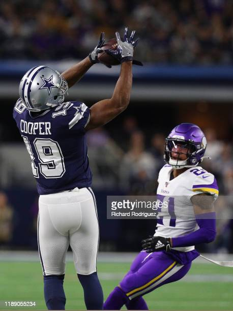 Amari Cooper of the Dallas Cowboys catches a pass over Mike Hughes of the Minnesota Vikings at ATT Stadium on November 10 2019 in Arlington Texas