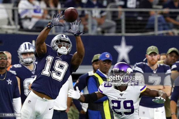 Amari Cooper of the Dallas Cowboys catches a pass over Xavier Rhodes of the Minnesota Vikings in the fourth quarter at AT&T Stadium on November 10,...