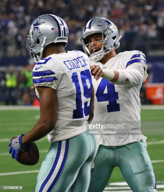 Amari Cooper of the Dallas Cowboys celebrates his second touchdown with Dak Prescott against the Philadelphia Eagles at ATT Stadium on December 09...