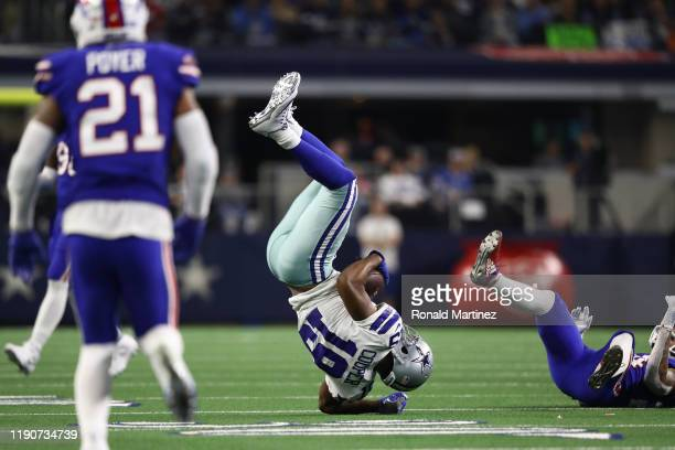 Amari Cooper of the Dallas Cowboys flips over Taron Johnson of the Buffalo Bills after making a pass reception in the second half at ATT Stadium on...
