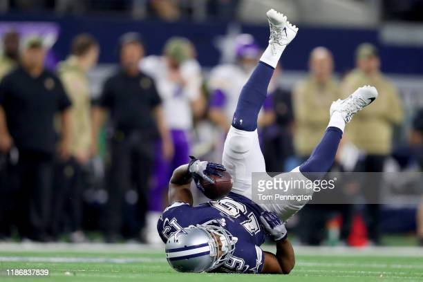 Amari Cooper of the Dallas Cowboys gets upended by the Minnesota Vikings in the fourth quarter at ATT Stadium on November 10 2019 in Arlington Texas