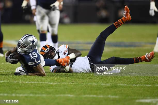 Amari Cooper of the Dallas Cowboys is brought down by Kevin Toliver of the Chicago Bears during the second half of a game at Soldier Field on...