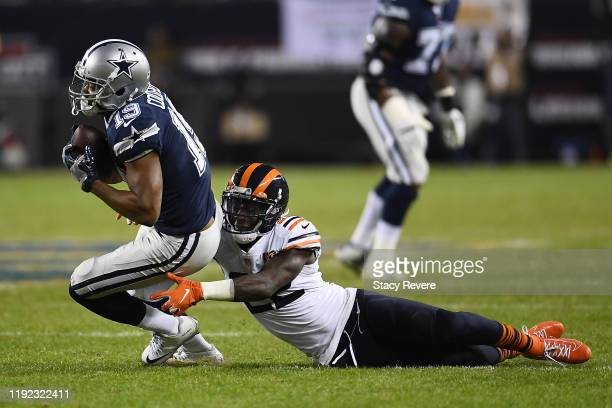 Amari Cooper of the Dallas Cowboys is brought down by Kevin Toliver of the Chicago Bears during a game at Soldier Field on December 05 2019 in...