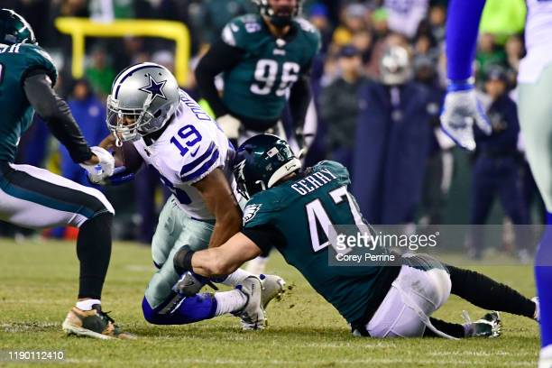 Amari Cooper of the Dallas Cowboys is tackled by Nate Gerry of the Philadelphia Eagles during the fourth quarter at Lincoln Financial Field on...
