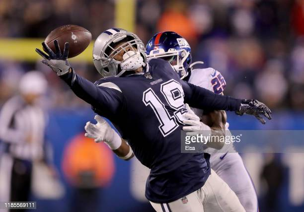 Amari Cooper of the Dallas Cowboys is unable to catch the ball as Corey Ballentine of the New York Giants defends in the fourth quarter at MetLife...