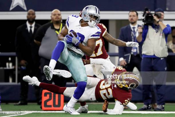 Amari Cooper of the Dallas Cowboys makes a catch while being guarded by Jimmy Moreland of the Washington Redskins in the second quarter in the game...