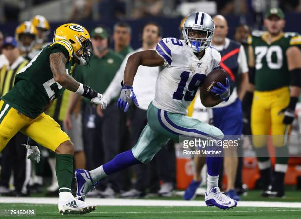 Amari Cooper of the Dallas Cowboys makes a touchdown pass reception against Jaire Alexander of the Green Bay Packers in the fourth quarter at AT&T...