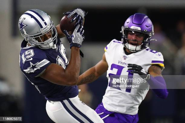 Amari Cooper of the Dallas Cowboys pulls down a pass against Mike Hughes of the Minnesota Vikings in the second quarter at ATT Stadium on November 10...