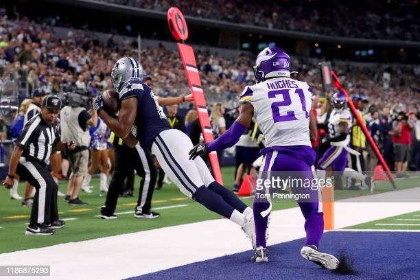 Amari Cooper of the Dallas Cowboys pulls in a pass for a touchdown against Mike Hughes of the Minnesota Vikings in the second half at ATT Stadium on...
