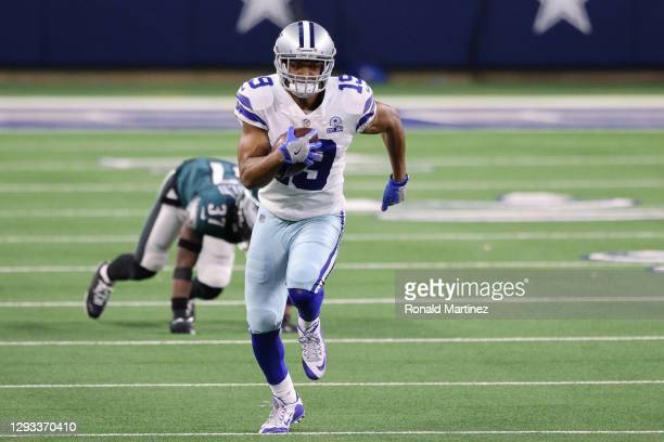 Amari Cooper of the Dallas Cowboys runs after making a catch in the third quarter against Grayland Arnold of the Philadelphia Eagles at AT&T Stadium...