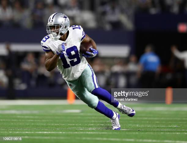 Amari Cooper of the Dallas Cowboys runs the ball after a catch against the Seattle Seahawks in the second half during the Wild Card Round at ATT...