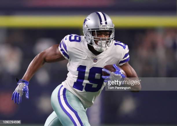 Amari Cooper of the Dallas Cowboys runs the ball after a reception in the first half against the Seattle Seahawks during the Wild Card Round at AT&T...
