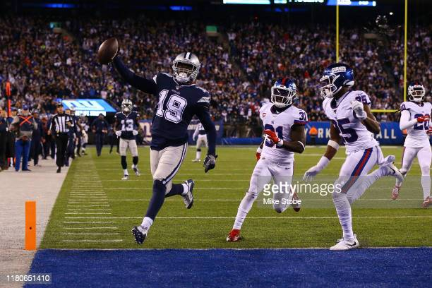 Amari Cooper of the Dallas Cowboys scores a fourth quarter touchdown against the New York Giants at MetLife Stadium on November 04 2019 in East...