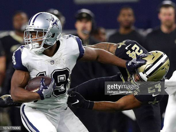 Amari Cooper of the Dallas Cowboys stiff arms Vonn Bell of the New Orleans Saints on a carry in the third quarter at ATT Stadium on November 29 2018...