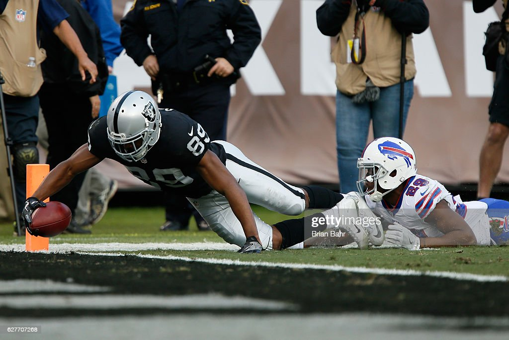 Amari Cooper #89 of the Oakland Raiders dives into the end zone for a touchdown against the Buffalo Bills during their NFL game at Oakland Alameda Coliseum on December 4, 2016 in Oakland, California.