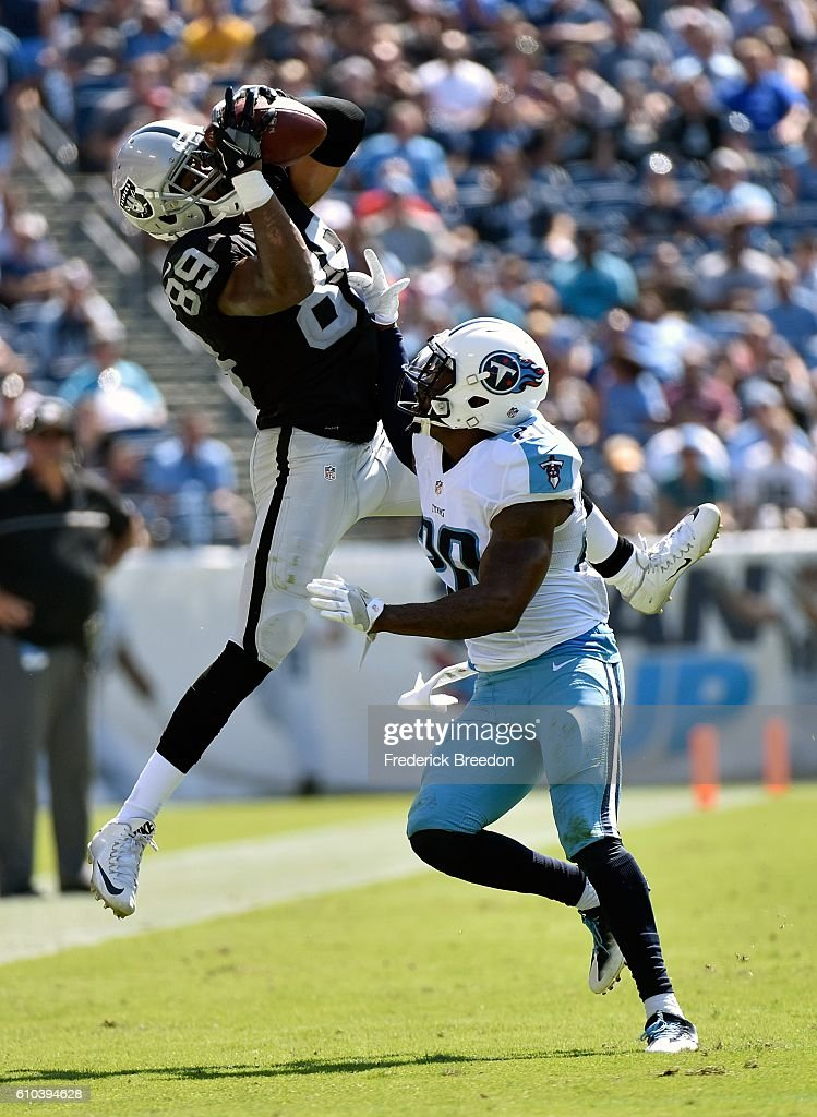 Amari Cooper #89 of the Oakland Raiders jumps for a reception over Perrish Cox #20 of the Tennessee Titans during the first half at Nissan Stadium on September 25, 2016 in Nashville, Tennessee.