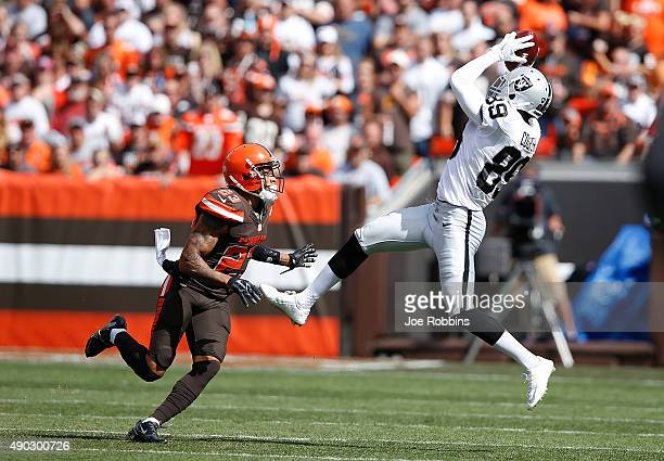 Amari Cooper of the Oakland Raiders makes a catch in front of Joe Haden of the Cleveland Browns during the first quarter at FirstEnergy Stadium on...