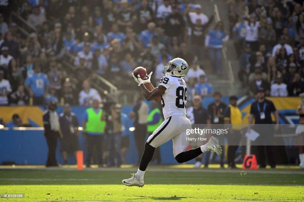 Amari Cooper #89 of the Oakland Raiders makes the 87 yard catch for a touchdown during the second quarter of the game against the Los Angeles Chargers at StubHub Center on December 31, 2017 in Carson, California.
