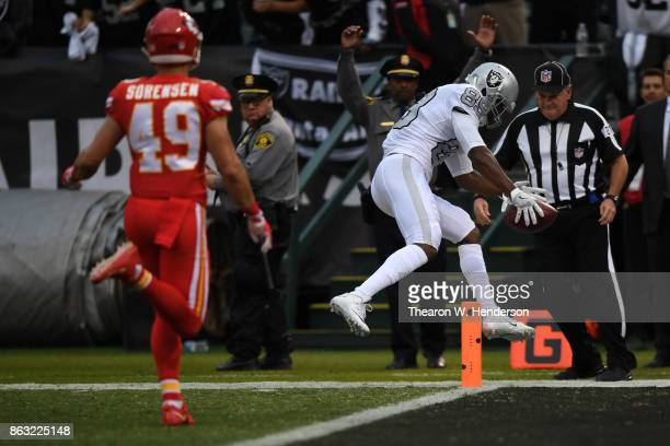 Amari Cooper of the Oakland Raiders scores a 38yard touchdown against the Kansas City Chiefs during their NFL game at OaklandAlameda County Coliseum...