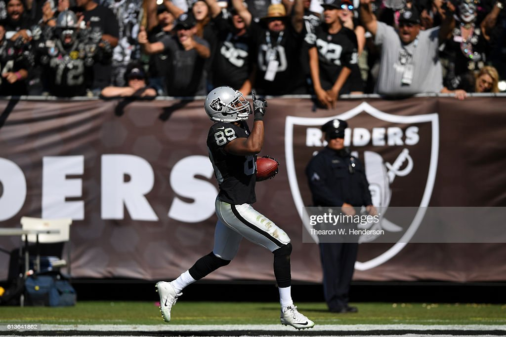 Amari Cooper #89 of the Oakland Raiders scores a 64-yard touchdown against the San Diego Chargers during their NFL game at Oakland-Alameda County Coliseum on October 9, 2016 in Oakland, California.