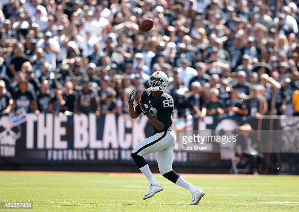 Amari Cooper of the Oakland Raiders scores a touchdown in the first quarter against the Baltimore Ravens at OaklandAlameda County Coliseum on...