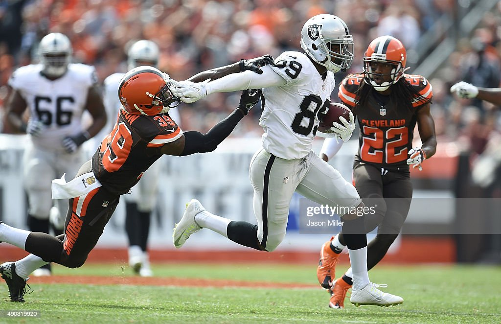 Amari Cooper #89 of the Oakland Raiders stiff arms Tashaun Gipson #39 of the Cleveland Browns during the second quarter at FirstEnergy Stadium on September 27, 2015 in Cleveland, Ohio.