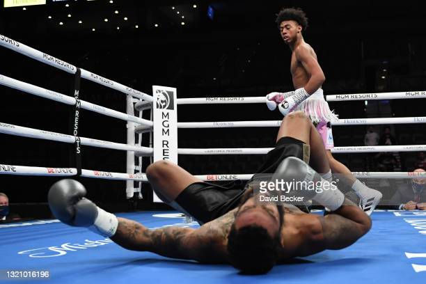 Amari Jones reacts after knocking down Jonathan Burrs during their super welterweight bout at Michelob ULTRA Arena on May 29, 2021 in Las Vegas,...