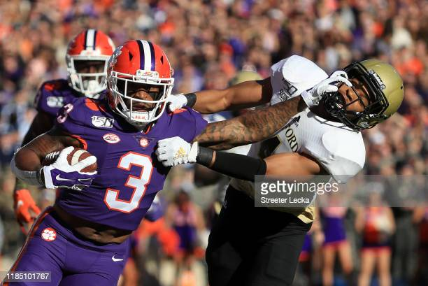 Amari Rodgers of the Clemson Tigers stiff arms Miller Mosley of the Wofford Terriers during their game at Memorial Stadium on November 02 2019 in...
