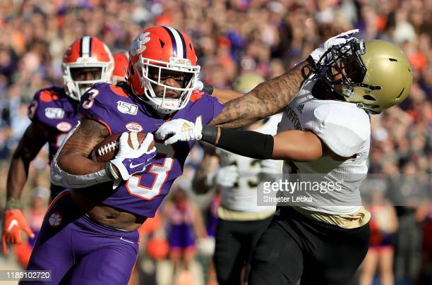 Amari Rodgers of the Clemson Tigers stiff arms Miller Mosley of the Wofford Terriers during their game at Memorial Stadium on November 02, 2019 in...