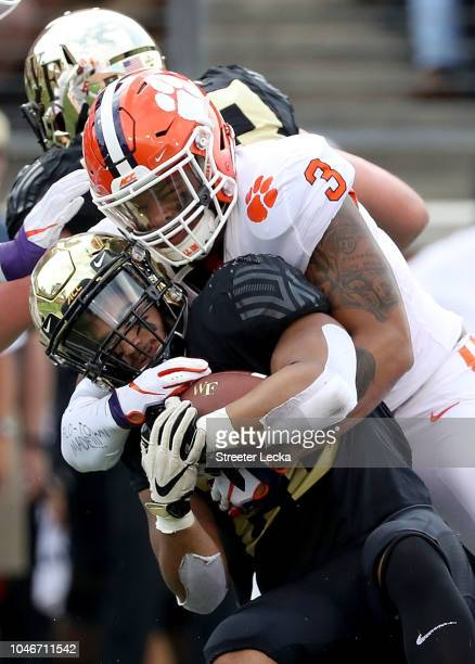 Amari Rodgers of the Clemson Tigers tackles Matt Colburn of the Wake Forest Demon Deacons during their game at BBT Field on October 6 2018 in Winston...