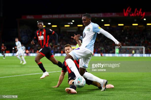 Amari'i Bell of Blackburn Rovers battles for the ball with Simon Francis of Bournemouth during the Carabao Cup Third Round match between AFC...