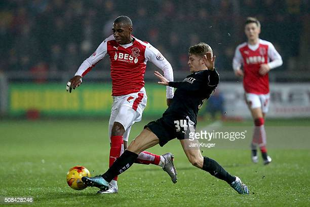 Amari'i Bell of Fleetwood Town battlers with Lloyd Isgrove of Barnsley during the Johnstone's Paint Trophy northern section semi final second leg...