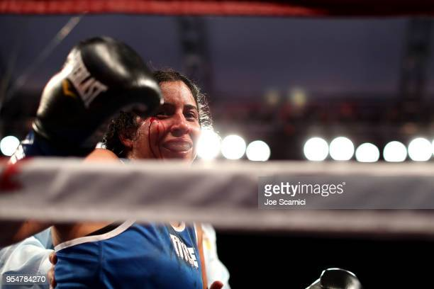 Amarilis Adorno waves to the crowd after being knocked out by Seniesa Estrada in the third round during the Flyweight Fight at StubHub Center on May...