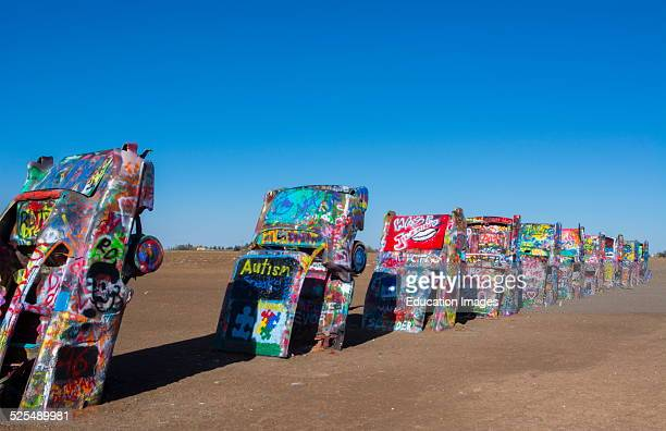 Amarillo Texas famous Cadillac Ranch off of Route 66 graphic look at old Cadillacs buried in ground on Route 66