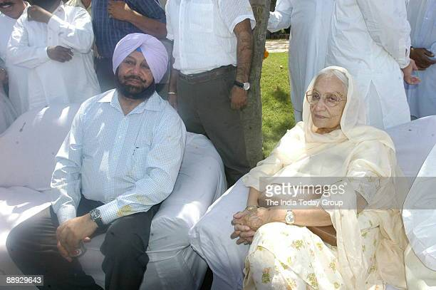 Amarinder Singh former Chief Minister of Punjab with his mother addressing the Media in New Delhi after coming back from the London He stayed there...