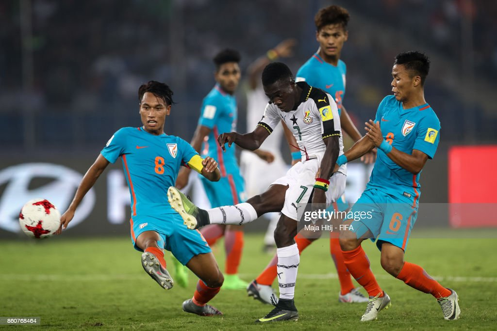 Amarjit Kiyam (L-R) of India, Ibrahim Sulley of Ghana and Suresh Wangjam of India battle for the ball during the FIFA U-17 World Cup India 2017 group A match between Ghana and India at Jawaharlal Nehru Stadium on October 12, 2017 in New Delhi, India.