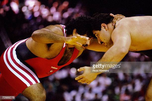 Amarjit Singh of Great Britain in action against Mehraban Roudbaneh of Iran in the prelims of the freestyle Wrestling at the 1996 Centennial Olympic...