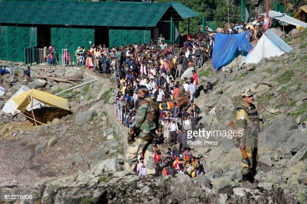 Amarnath yatra continue to travel to the holycave after a militant attack At least seven Amarnath yatris were killed and 20 others injured when...