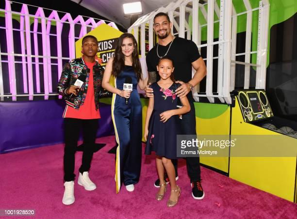 Amarr M Wooten Lilimar Hernandez wrestler Roman Reigns and JoJo Anoa'i attend the Nickelodeon Kids' Choice Sports 2018 at Barker Hangar on July 19...