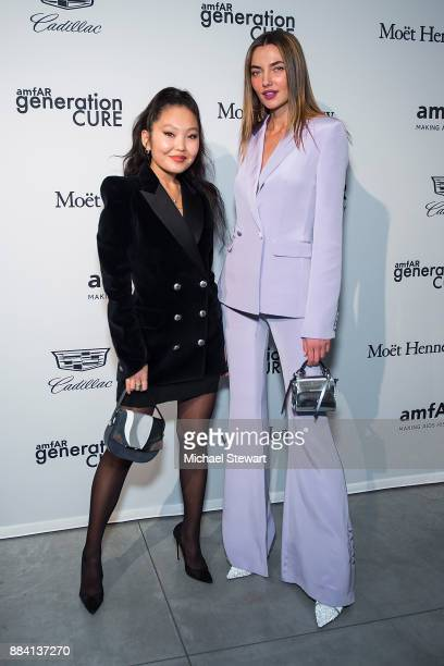 Amarsana Gendunova and Alina Baikova attend the 2017 amfAR generationCURE holiday party at the Cadillac House on December 1 2017 in New York City