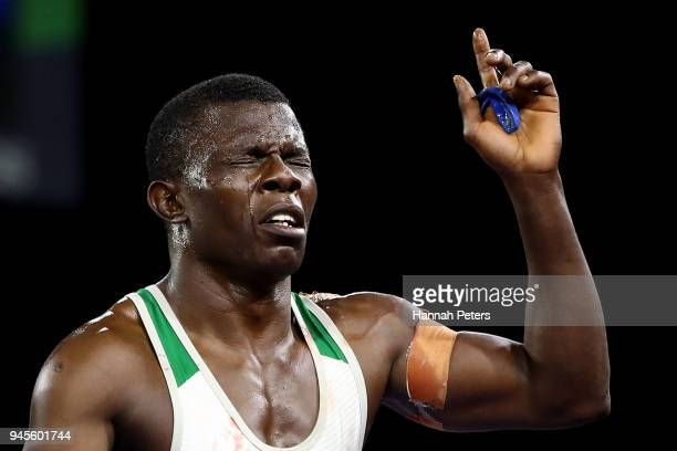 Amas Daniel of Nigeria celebrates victory over Vincent de Marinis of Canada in the Men's Freestyle 65 kg Bronze match on day nine of the Gold Coast...