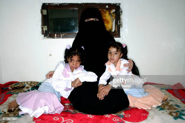 Amat Al Saboor Ali Qassan, wife of Guantanamo prisoner Salim Hamdan, is photographed with her two daughters Fatima and Salma at home in her bedroom...